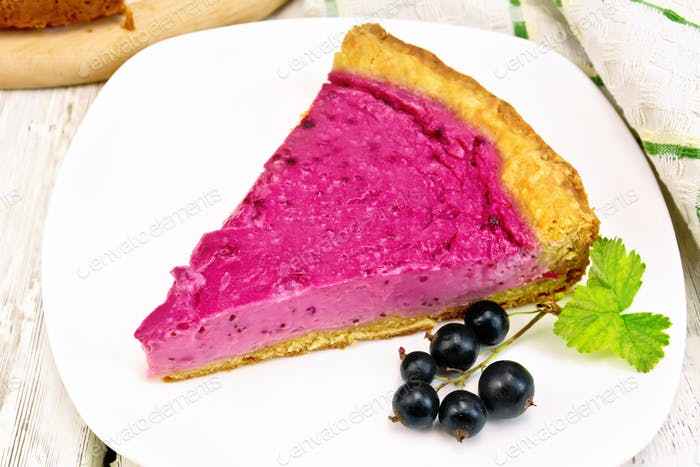 Pie of black currants in plate on board