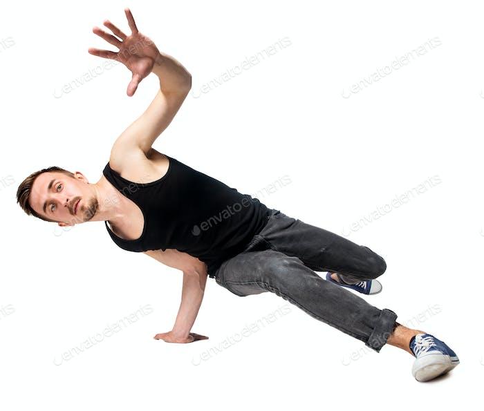 Break Tänzerin tun einhändige Handstand vor einem weißen Hintergrund