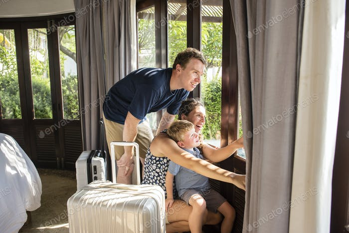 Family checking in to a resort