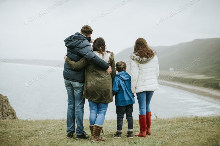 Parents with their children looking at the ocean