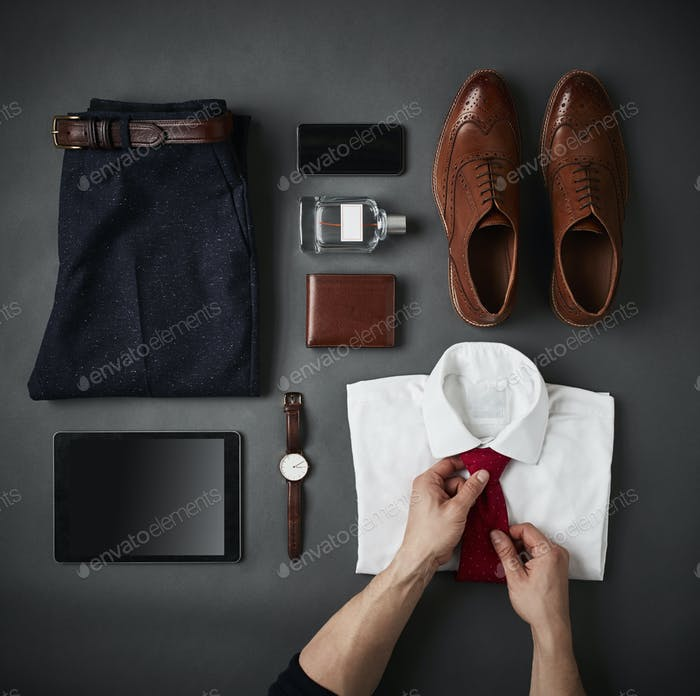 Person Arranging Male Business Clothing And Digital Tablet