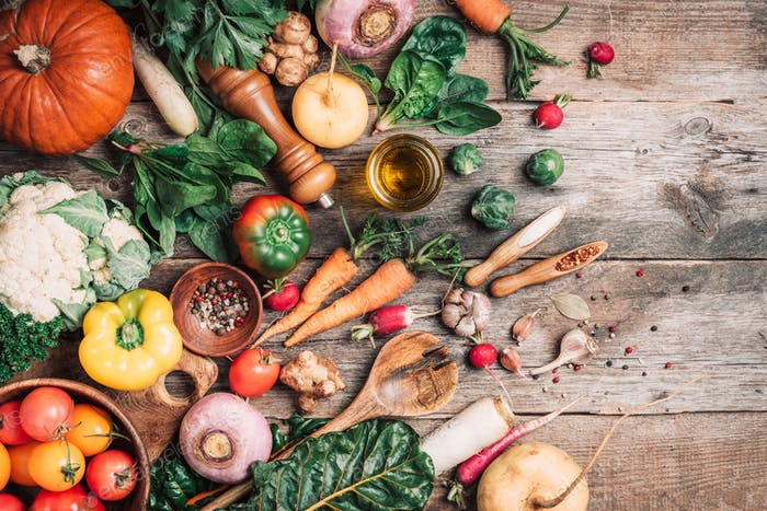 Organic food. Harvest of fresh vegetables on wooden background. Top view. Copy space. Diet or