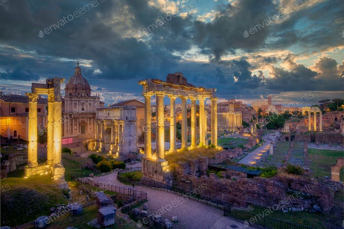 Forum Romanum archeological site in Rome with dramatic colorufl sky