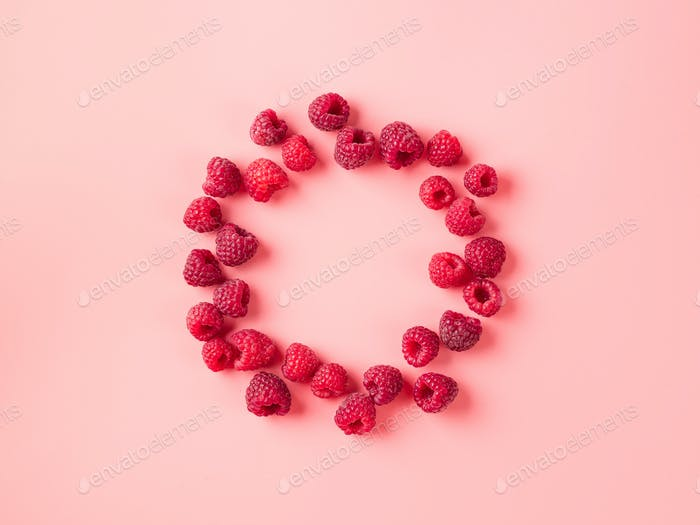 Raspberry in round shape on pink, copy space