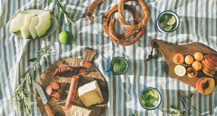 Picnic set with fruit, cheese, toast, honey, wine