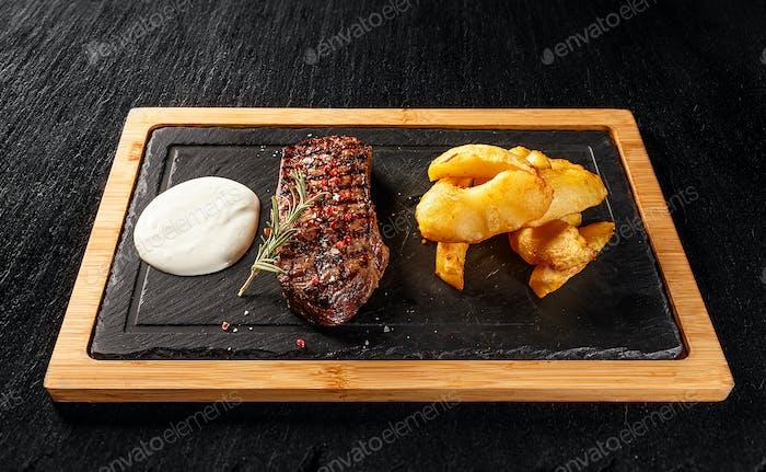 Sirloin steak with golden potatoes