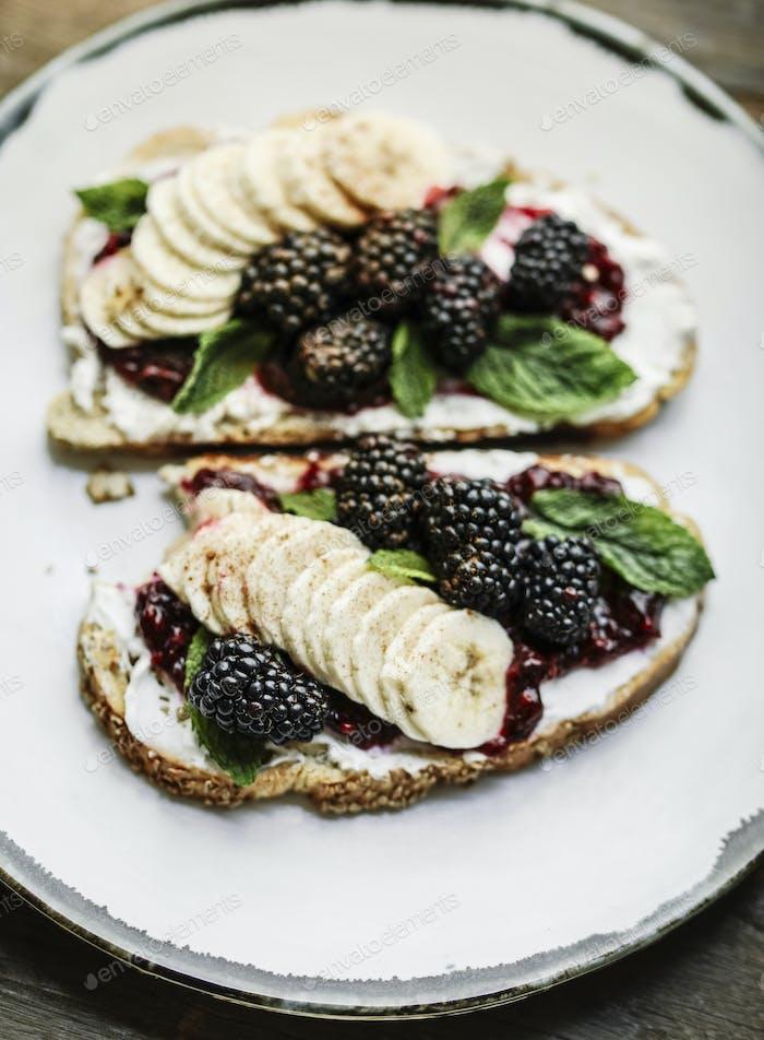 Blackberry jam with vegan cream cheese on toast