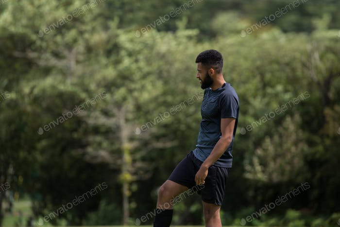 Football player taking break in the ground