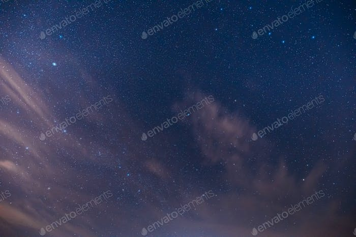 Real Night Sky Stars. Colorful Starry Sky With Some Clouds Background Backdrop