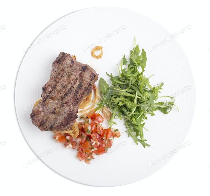 Köstliches Rindfleisch Steak mit Rucola.