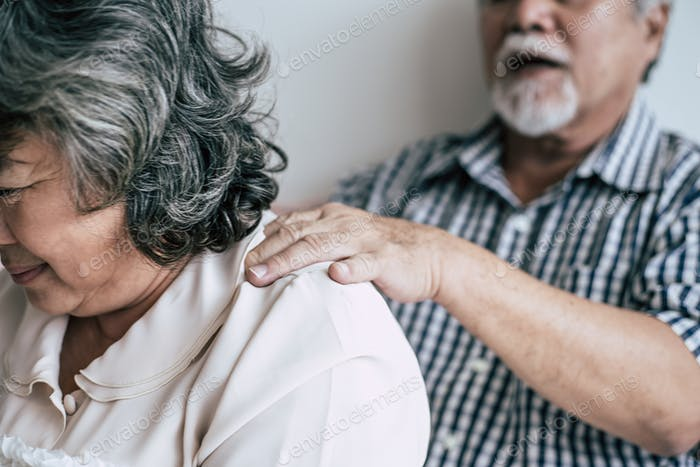 Senior man giving a massage to his wife