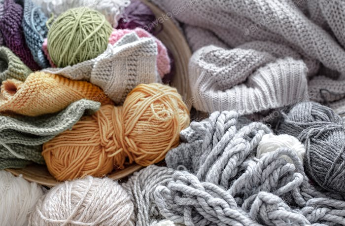 Different yarn for knitting in pastel and bright colors.