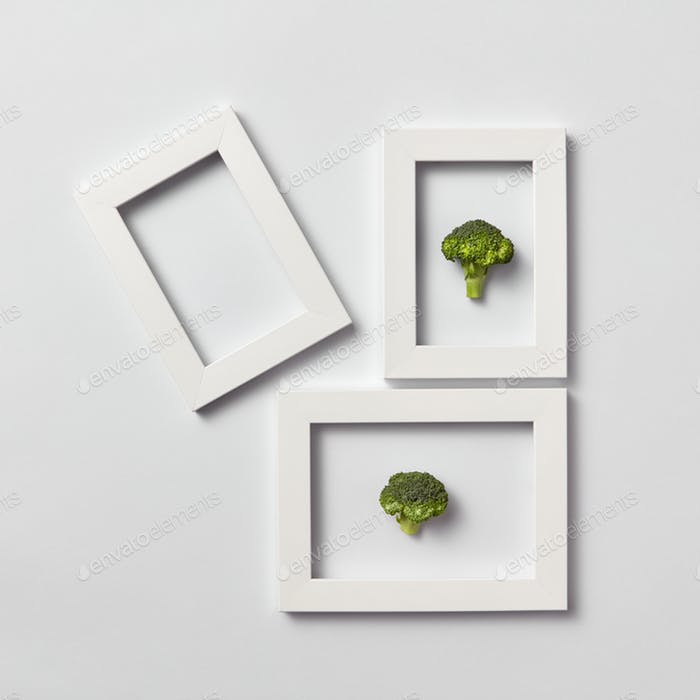 Creative pattern of frames with natural organic broccoli on a light background