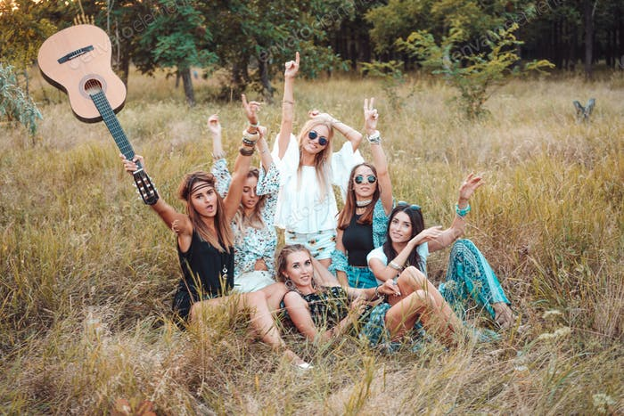 Six girls in nature have fun