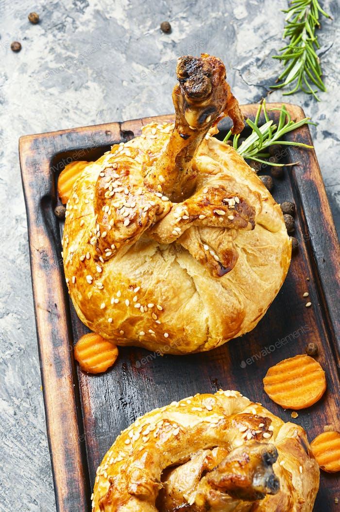 Chicken leg baked in dough