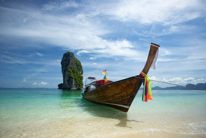 Traditional longtail boat and Poda island, Thailand.
