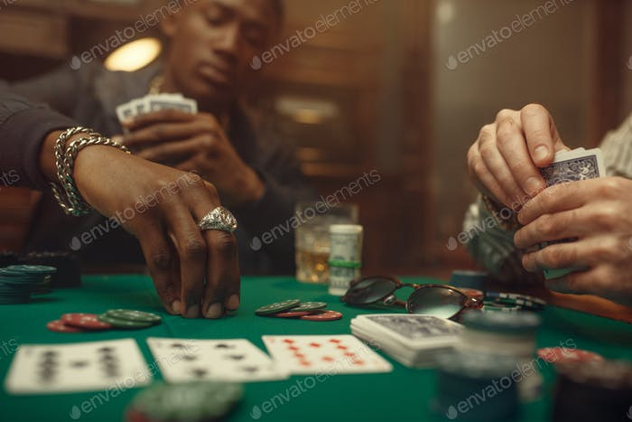 Two poker players place bets in casino