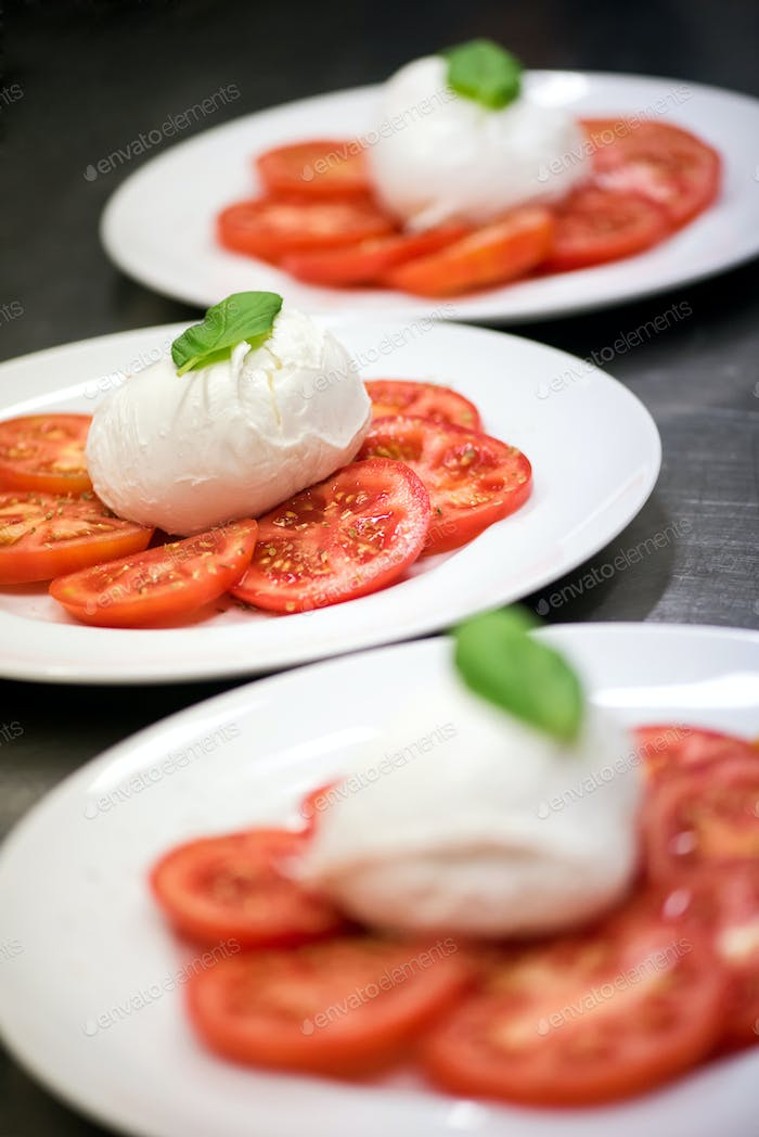 Three plates of fresh Italian Caprese salad