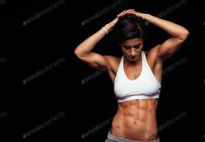 Female athlete with perfect abs