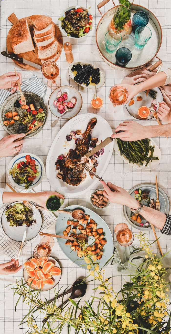 Flat-lay of people eating and drinking rose wine, vertical composition
