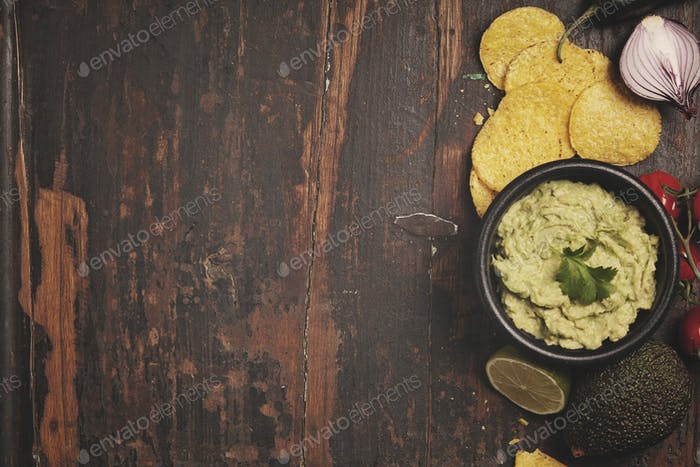 Mexican nachos chips with fresh guacomole sauce