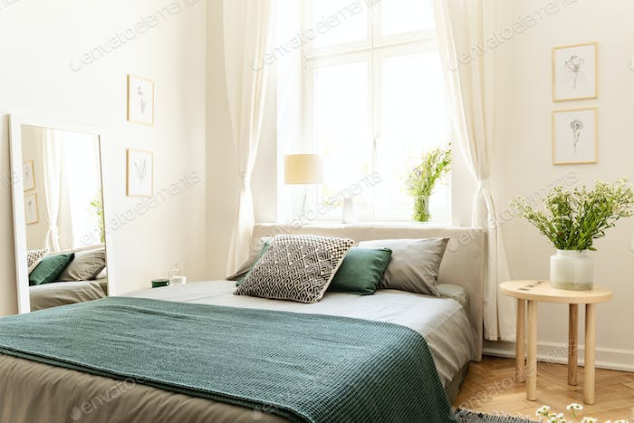 Eco cotton linen and blanket on a bed in nature loving family gu