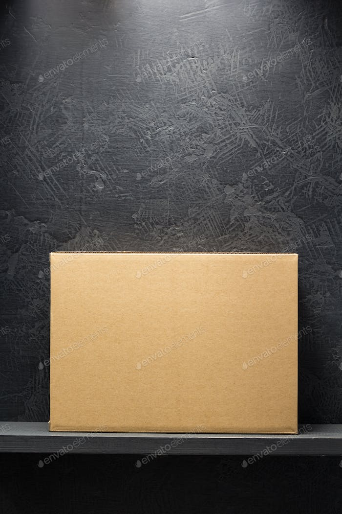 cardboard box on black background