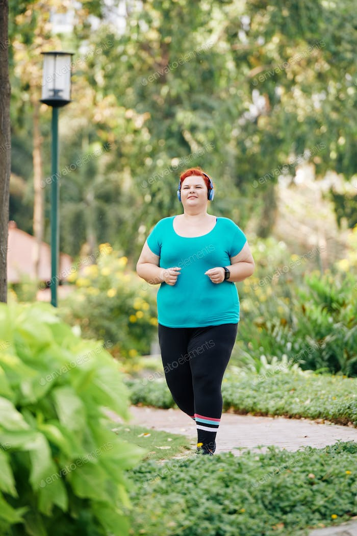Jogging overweight woman