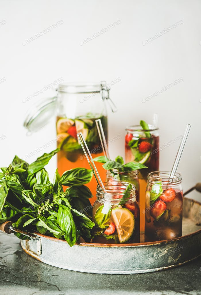 Fresh strawberry and basil lemonade or iced-tea in glasses