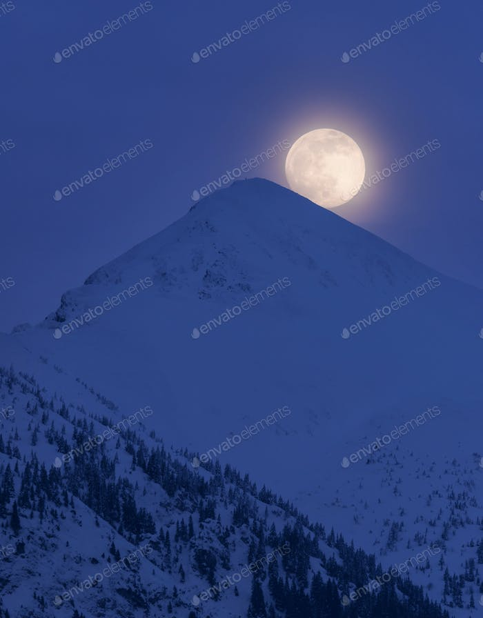 Full Moon rising behind the mountain