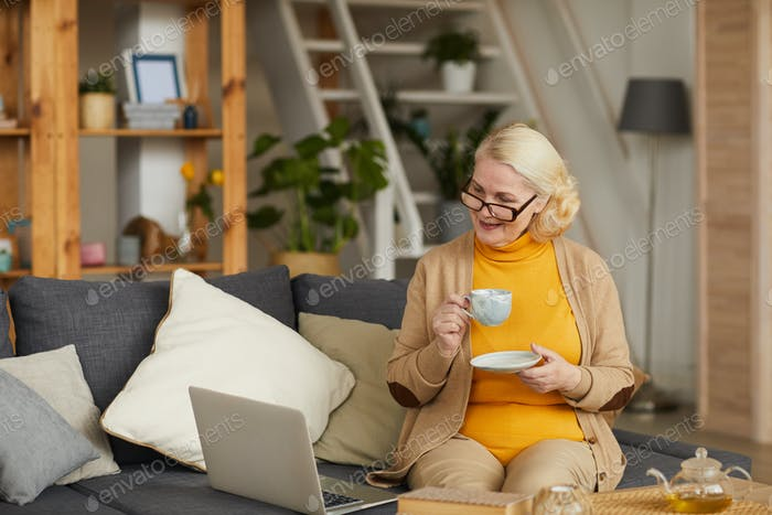 Senior woman spending time at home