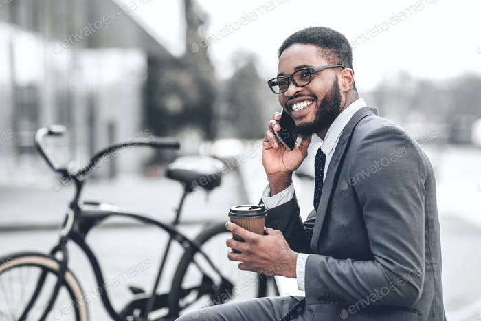 No time for break. Millennial businessman talking on phone