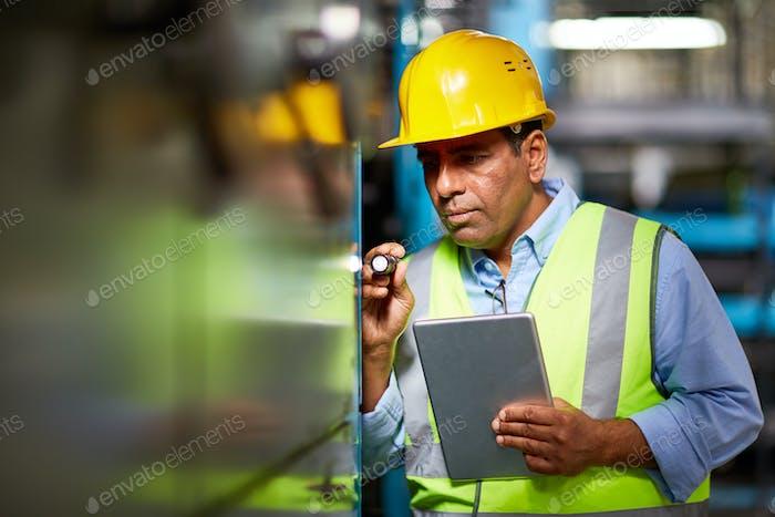 Engineer with flashlight