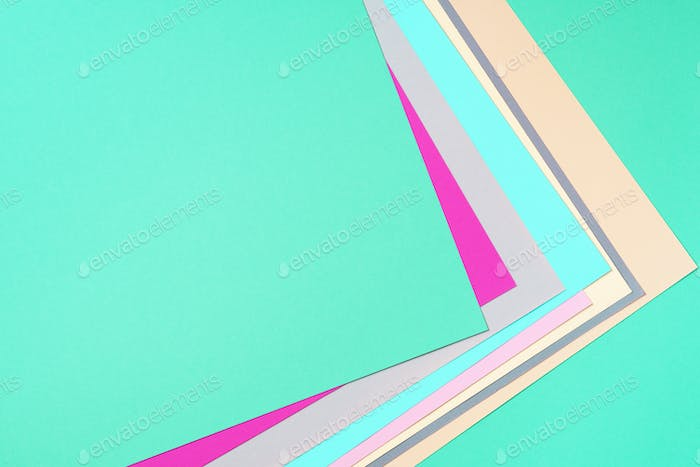Colorful trendy green and pink paper background. Top view. Copy space