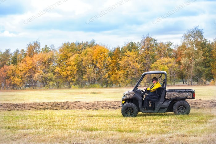 Hunting quad bike with driver in mask