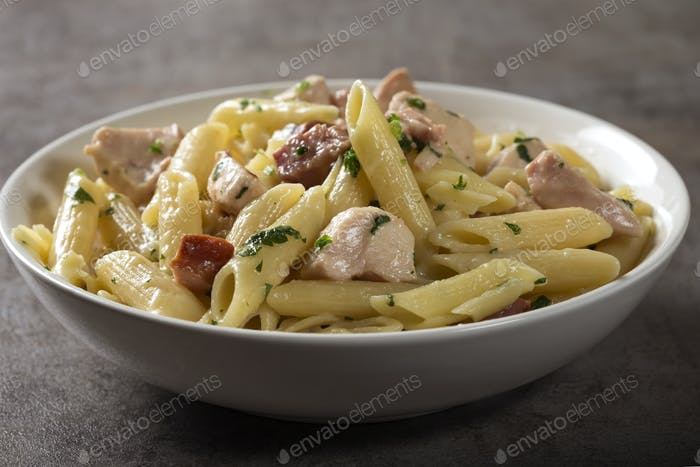 Italian pasta with chicken meat and bacon
