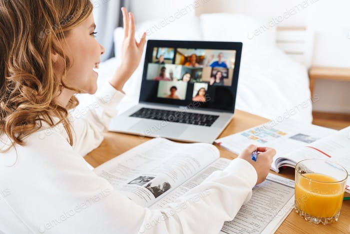Photo of caucasian happy girl gesturing peace while studying online