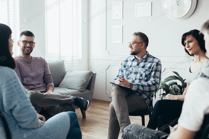 Group meeting with counselor for people trying to gain life balance