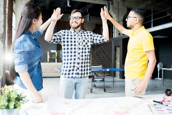 Creative Business Team High Five in Office