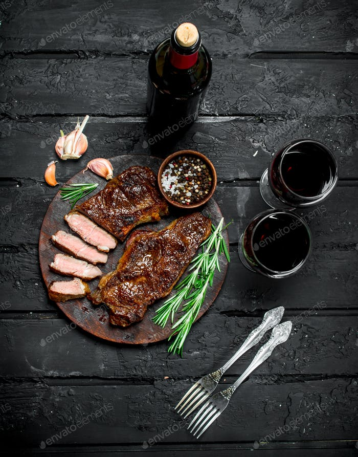 Grilled beef steak with red wine.