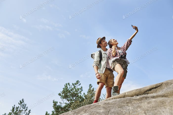 Backpackers making a selfie during hiking trip