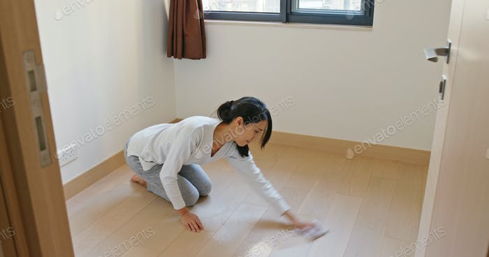 Asian Housewife woman wash the floor with rag