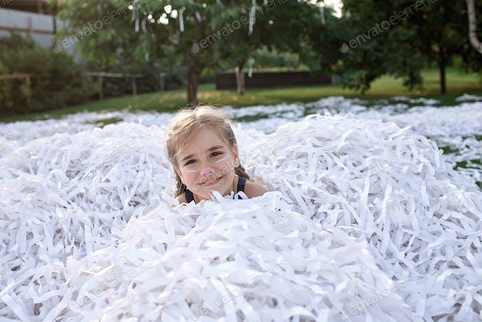 Happy kids enjoy paper show on backyard, outdoor birthday party, celebration in the garden