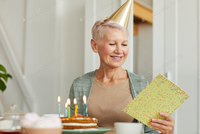 Birthday woman with card