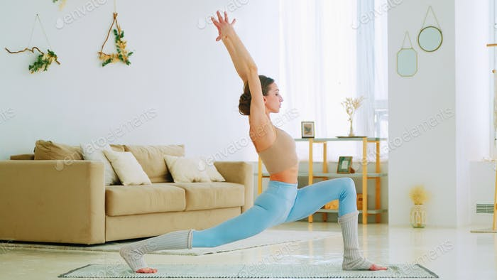 Young woman doing yoga exercise for stress relief relaxing from work