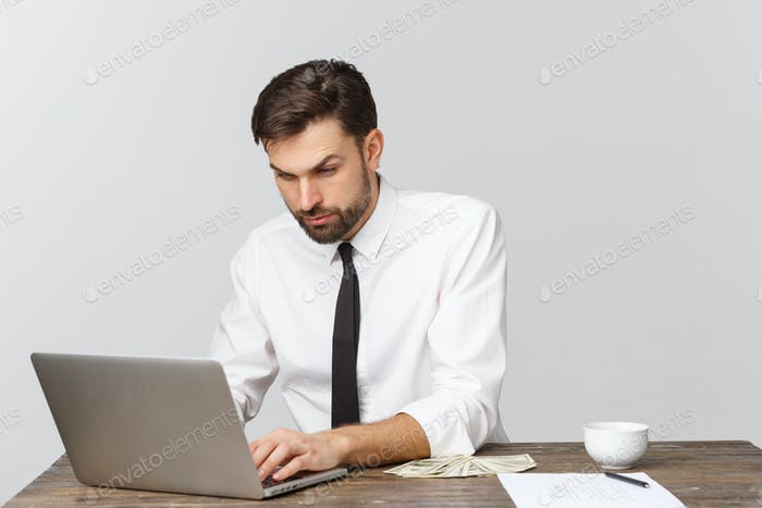 unhappy male working in the office, looking at the camera, front view, isolated on white