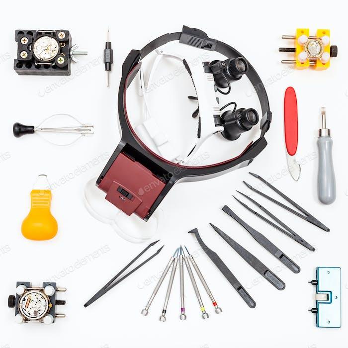 Draufsicht verschiedener Artikel für die Reparatur Uhr