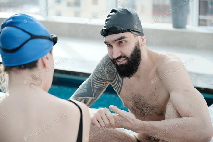 Bearded man cheering swimmer