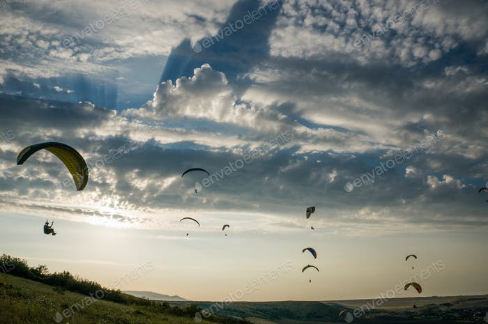 People Flying on Paragliders, Sky With Clouds on Background, Ukraine, Crimea