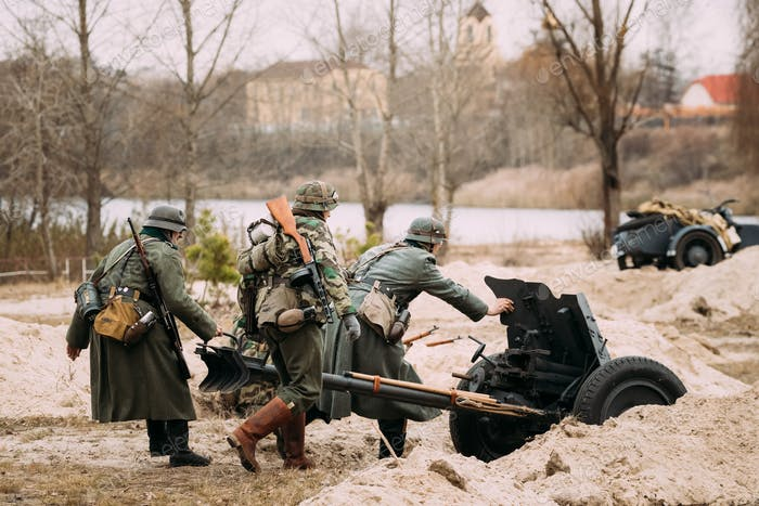 Re-enactors Dressed As German Wehrmacht Soldiers In WWII Roll Ou